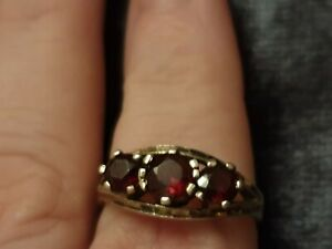 925 Sterling  Silver And Garnet Gypsy Style Ring. Size 0 3.04g