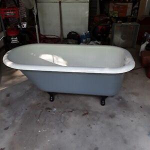 Antique cast iron claw foot tub
