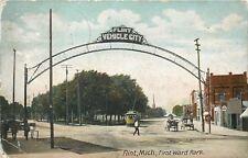 Flint MI~Vehicle City Arch~Trolley, Wagons, Dentist? 1st Ward Park~1910 Postcard