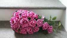 fuschia pink bouquet with dimantes, ribbon and a handle. perfect condition