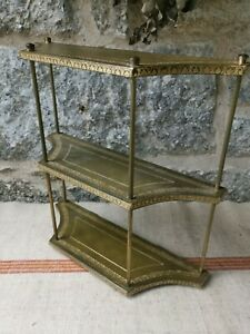 A Brass and Leather Display Shelf