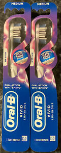NEW Lot of 2 Oral B Vivid Luminous Medium Toothbrush