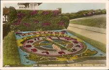 real photo; Hastings white rock gardens; floral cuckoo clocks; 1938; S&E