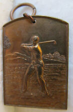 VINTAGE UNIQUE BRONZE GOLF MEDAL WITH MALE GOLFER AT THE TOP OF HIS SWING