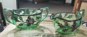 Vintage rare Green Glass cream and sugar with sterling silver overlay and trim.