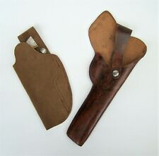 2 x PISTOL HOLSTERS, A VINTAGE BROWN LEATHER AND A MODERN SUEDE TYPE