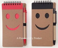 Pack Of 2 Smiley Face Note Books With Pens and Recycled Materials.