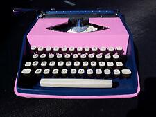 Beautiful pink/blue vintage Remington portable typewriter with case
