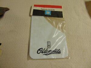 NOS GM SPLASH GUARDS OLDSMOBILE 997703 1980S