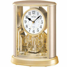 NEU Rhythm Kamin Tischuhr Quarz Kaminuhr Champagner Drehpendel Pendel Büro Uhr