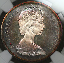 1965 Canada Silver 1 Dollar Small Beads Pointed 5 NGC PL65 Rainbow Toned BU H10