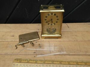 Vintage Schatz 8 Day Mantel Clock with base balance. Sold for parts but working