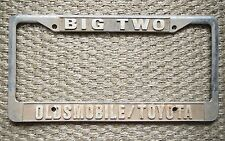 Big Two Oldsmobile/Toyota Dealership License Plate Frame Metal Embossed Old Rare