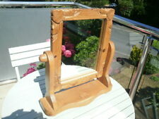 A VERY NICE PINE SWIVEL DRESSING TABLE MIRROR WITH  CARVED FRAME