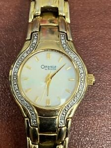 Ladies Caravelle By Bulova Mother Of Pearl Gold Tone Watch With Diamond Chips