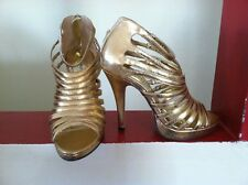 gold color  heel,sz 6,see bottom details