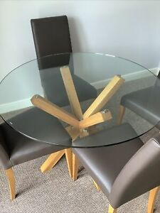Round glass wooden legs dining table and 4 brown 100% leather chairs