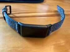 Fitbit Charge 4 - Used with reflective band. Includes Charger