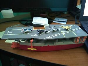 micro machines aircraft carrier and military airplanes