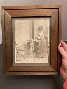 Vintage R Hendrickson sepia framed print.. Woman bathing child