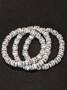 Set Of 3 Black White Acrylic Skull Stretch Bracelets