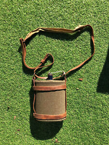 Australian WW2 blue enamelled water canteen in leather harness. NAMED