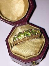Vintage Half Hoop Five Stone Peridot ring in 9K Yellow Gold. Circa 1960's.