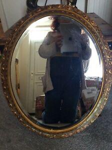 Vintage Plaster and Wood Ornate Oval Bevelled Gilt Mirror