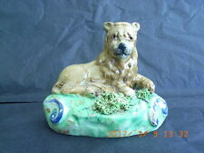 Staffordshire Pearlware Walton Figure of a Recumbent Lion on a Grassy Base