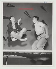 1950'S YOUNG JOHNNY CARSON ORIGINAL CANDID PHOTO INTERVIEWING ON A TRAMPOLINE