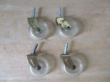 Four Vintage Plastic and Brass Caster Wheels