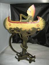 Metal folk art pendulum balance indian in canoe paddling rocking