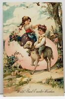 Easter Boy Riding Lamb Girl in Large Egg Embossed Winona to Morgan Postcard G12