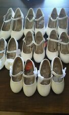 girl's shoes white colors different sizes and designs.