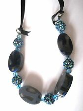 Blue Oval Acrylic Bead and Sparkling Glitter Ball Bead Statement Necklace
