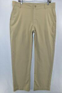 Under Armour UA Loose Fit Lightweight Golf Pants Mens Size 34 Tan Meas. 35x32
