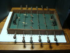 very early foosball game, lead figurs