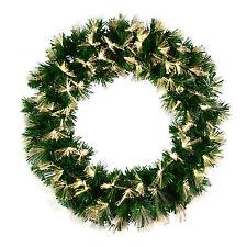 Weihnachts- Kränze, Girlanden und Pflanzen in Grün