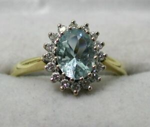 Beautiful 18 carat Gold Aquamarine And Diamond Cluster Ring Size M.1/2