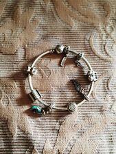 Genuine Pandora Bracelet   marked s925 ALE   with a mix of pandora charms
