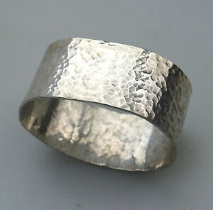 A vintage Arts & Crafts solid silver hand beaten Napkin Ring 31.94g C. 1981