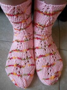 Hand knitted lace pattern socks, pink with colors