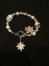 Christmas painted snowflake clear beaded bracelet with silvertone closure