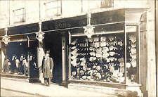 Sherborne. Lowman & Sons Tailors & Outfitters Shop. Man in Doorway.