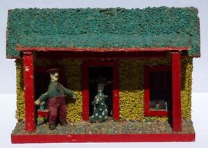 Folky Model Cabin with a carved man and woman. Great character, unusual,detailed