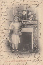 CL25.Vintage French Greetings Postcard. Girl with lots of shoes and boots.