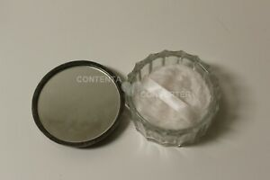 Round glass make up container with mirror attached to lid with puffy applier