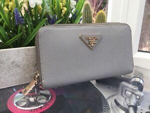 Pale blue / grey prada zip around purse