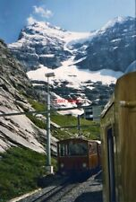 PHOTO  THE 'OLD TIMER' TRADITIONALZUG ON THE DECENT FROM JUNGFRAUJOCH CROSSES TH