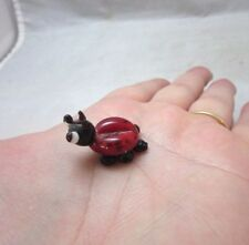 Miniature blown glass insect lady bug
